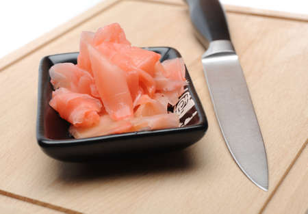 pink ginger ingredient for sushi on wooden board. isolated Stock Photo - 11079838