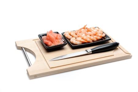 fresh shrimps and ingver on wooden board isolated. sushi ingredient Stock Photo - 11079811