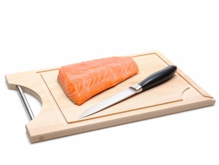 fresh raw salmon fish on wooden board isolated. sushi ingredient Stock Photo - 11079791