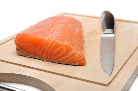 fresh raw salmon fish on wooden board isolated. sushi ingredient Stock Photo - 11079841