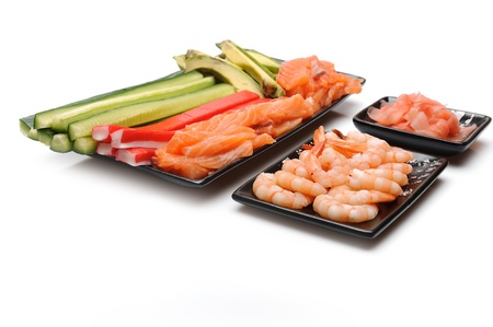 ingredients for sushi making. salmon, cucumber, avocado, shrimps, ginger, crab sticks. isolated Stock Photo - 11079830