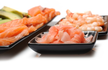 ingredients for sushi making. salmon, cucumber, avocado, shrimps, ginger, crab sticks. isolated Stock Photo - 11079817