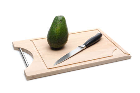green avocado on wooden board isolated on white. sushi ingredients Stock Photo - 11257397