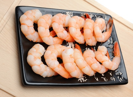 fresh shrimps on wooden board isolated. sushi ingredient Stock Photo - 11257414