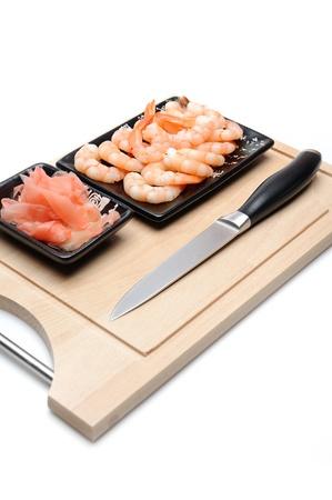 fresh shrimps and ingver on wooden board isolated. sushi ingredient Stock Photo - 11257398