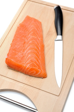 fresh raw salmon fish on wooden board isolated. sushi ingredient Stock Photo - 11257416