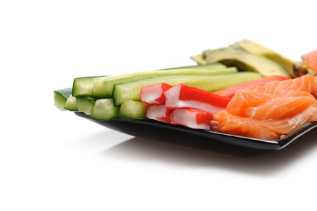 ingredients for sushi making. salmon, cucumber, avocado, shrimps, ginger, crab sticks. isolated Stock Photo - 11257394