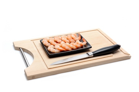 fresh shrimps on wooden board isolated. sushi ingredient Stock Photo - 11423197