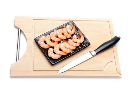 fresh shrimps on wooden board isolated. sushi ingredient Stock Photo - 11423216