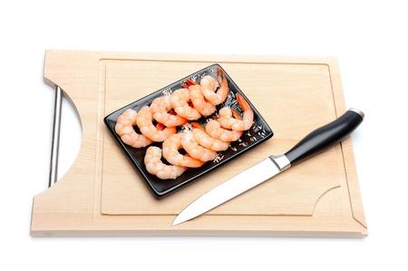 fresh shrimps on wooden board isolated. sushi ingredient Stock Photo - 11423216