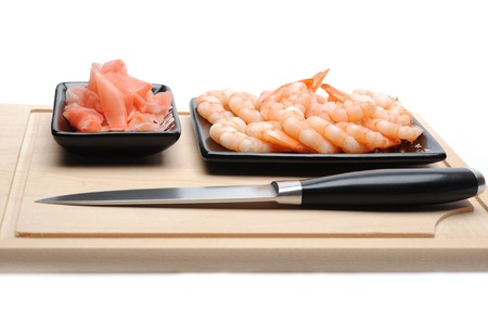 fresh shrimps and ingver on wooden board isolated. sushi ingredient Stock Photo - 11423206