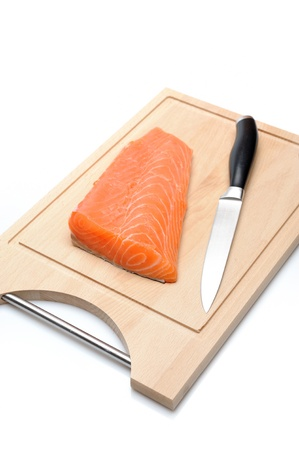 fresh raw salmon fish on wooden board isolated. sushi ingredient Stock Photo - 11423208