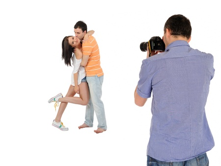 professional male photographer making family picture at studio. isolated Stock Photo - 11423215