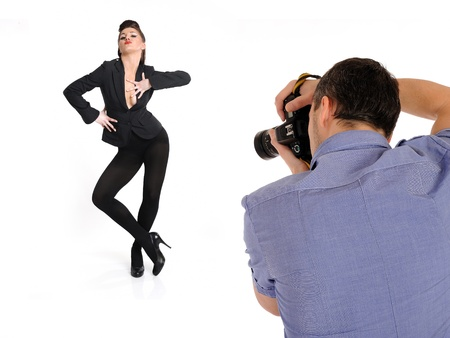 professional male photographer at studio fashion shot with a model. isolated Stock Photo - 11423220