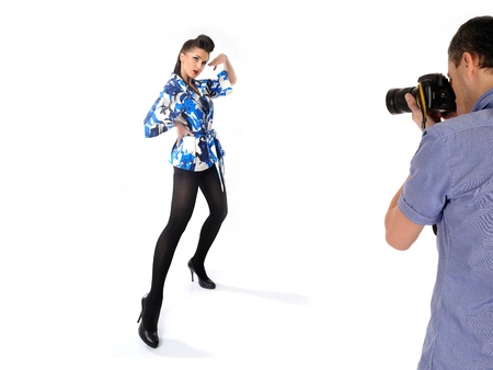 professional male photographer at studio fashion shot with a model. isolated Stock Photo - 11423198