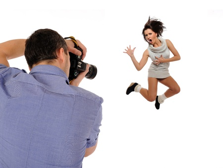 professional male photographer at studio fashion shot with a model. isolated photo