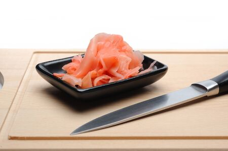 pink ginger ingredient for sushi on wooden board. isolated photo