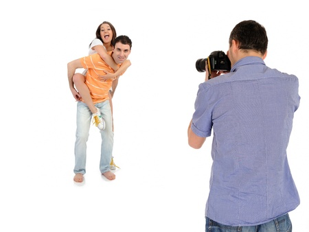 photo shooting: professional male photographer making family picture at studio. isolated