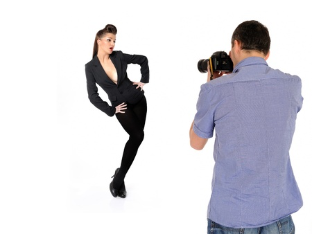 professional male photographer at studio fashion shot with a model. isolated Stock Photo - 11890617