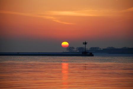winter sunrise: Winter sunrise on Lake Michigan  Navy Pier , Chicago downtown, Illinois Stock Photo