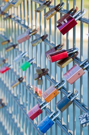 sweethearts: STRASBOURG, FRANCE. 31st August 2016. Sweethearts are beginning to place love padlocks on the Passerelle Mimram, the famous pedestrian bridge linking France and Germany over the Rhine.