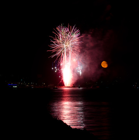 PLYMOUTH, ENGLAND. 10th August 2017. The moon rises during the British Firework Championships, a huge firework competition held annually in Britains Ocean City.
