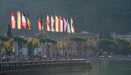 GARDA, VENETO, ITALY. 26th October 2017. A row of European flags backlight by the Autumn sun. The union flag of the united kingdom has disappeared - perhaps foreshadowing Britains exit from the EU? Editorial