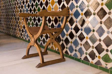 moresque: Chair in front of moorish wall