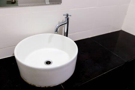 round White sink in black bathroom Stock Photo