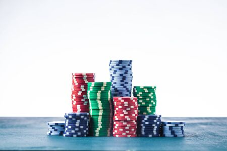 Stack of poker chips on the table on a white background isolate Banque d'images - 134842758