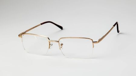 Gold eyeglasses on white background isolate Banque d'images - 134842759