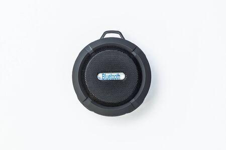 Round Bluetooth speaker black on white background Banque d'images - 134842767