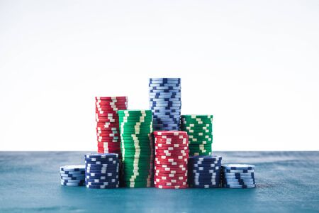 Stack of poker chips on the table on a white background isolate Banque d'images - 134842828