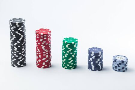 Poker chips on a white background different stacks of isolate Banque d'images - 134842840