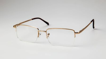 Gold eyeglasses on white background isolate Banque d'images - 134842842