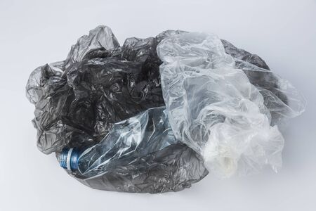Plastic bags and crumpled bottles on a light background Banque d'images - 135168340