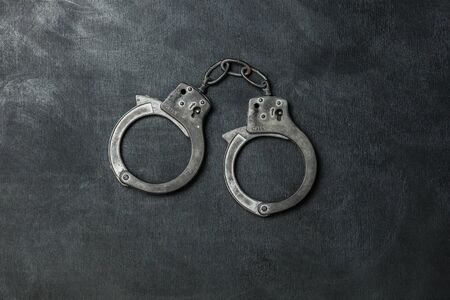 The Handcuffs on black background Banco de Imagens