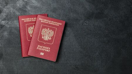 two Russian passports on a black background copy space