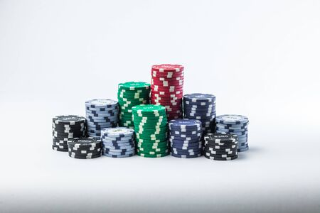 Stack of poker chips on a white background Banque d'images - 134842958