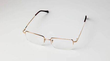 Gold eyeglasses on white background isolate Banque d'images - 134843046
