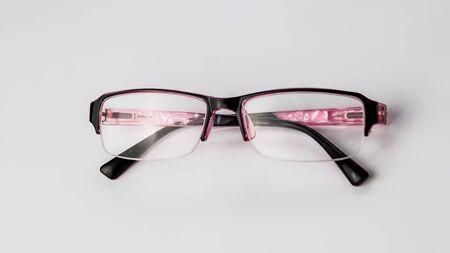 Pink Glasses for vision on a light background. Banque d'images - 135168348