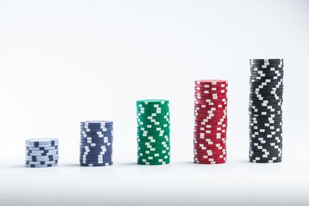 Poker chips on a white background different stacks