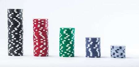 Poker chips on a white background different stacks of isolate Banque d'images - 134843132