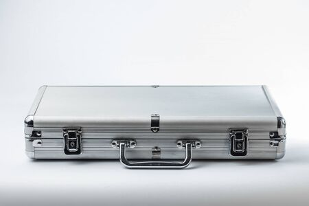 Metallic suitcase on white background Banque d'images - 134843136