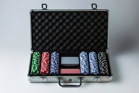 Suitcase with poker set on a light background Archivio Fotografico