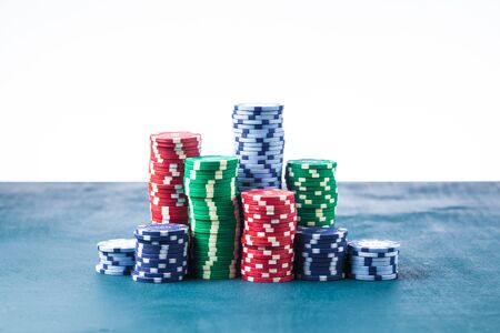 Stack of poker chips on the table on a white background isolate Banque d'images - 135168486