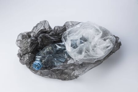 Plastic bags and crumpled bottles 免版税图像