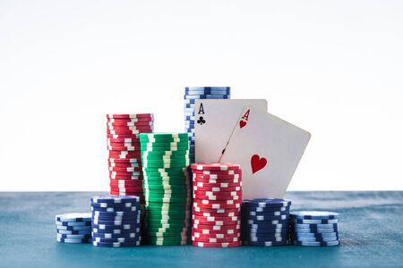 stack of poker chips with two aces on a white background isolate