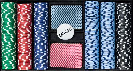 Poker set with chips cards and dealer, top view