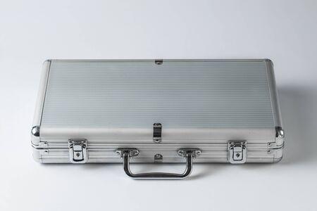 Metallic suitcase on white background